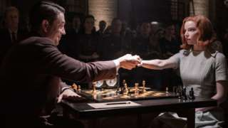 Scene from The Queen's Gambit showing the characters Beth Harman and Soviet chess master Vasily Borgov