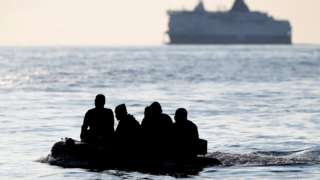 A boat carrying migrants in the English Channel