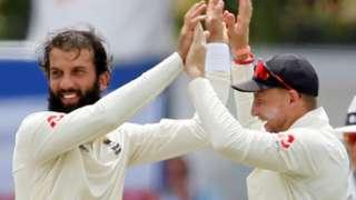 Moeen Ali and England captain Joe Root celebrate