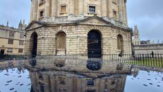 Oxford University's Radcliffe Camera reflected on a car roof