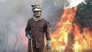 Firefighters trying to extinguish a fire in the Amazon rainforest, in Rio Branco, Acre State, 24 August 2019