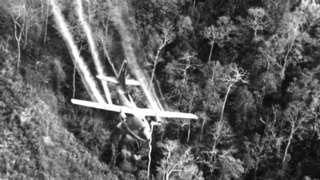 US air force jet flies over an area near Saigon spraying Agent Orange in 1968