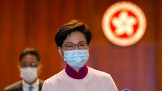Hong Kong Chief Executive Carrie Lam reacts as she leaves the chamber after delivering her final annual policy address at the Legislative Council in Hong Kong, China October 6, 2021.