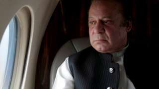 Pakistani Prime Minister Nawaz Sharif looks out the window of his plane after attending a ceremony to inaugurate the M9 motorway between Karachi and Hyderabad, Pakistan February 3, 2017.