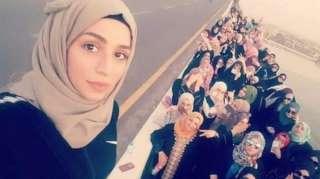 Riham Yaqoob leading a women's march (Twitter).