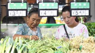 Citizens buy agricultural and sideline products in the supermarket poverty alleviation sales zone. Guiyang City, Guizhou Province, China, September 9, 2020.-