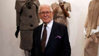 Pierre Cardin stands in front of dummies bearing his clothes, 2014