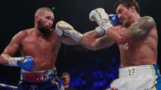Tony Bellew hits Oleksandr Usyk with a left hand
