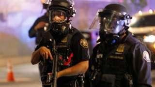 Police confront demonstrators as Black Lives Matter supporters demonstrate in Portland, Oregon on July 4, 2020