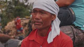 Mr Salvador who lost his son in the flood