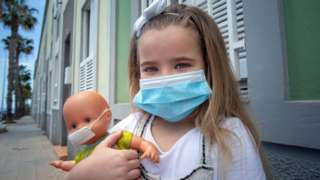 Child wearing a face mask in Tenerife, Spain