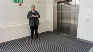 Cllr Kerry Smith with the carpet