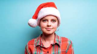 Young woman with Santa hat