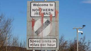 Signage welcoming motorists from the Irish Republic into Northern Ireland is pictured on the main Dublin/Belfast motorway near Newry on January 1, 2021