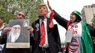 Iranian demonstrators carry portrait of Ayatollah Ali Khamenei and an effigy of US President Donald Trump - 10 May 2019