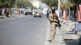 An Afghan security officer stands guard after an explosion in Kabul, Afghanistan, 09 September 2020.