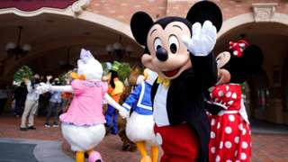 Mickey Mouse greets visitors