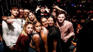 Olivia Grist and friends in a nightclub