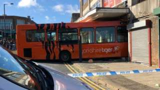 bus crashes in to shop in Shipley