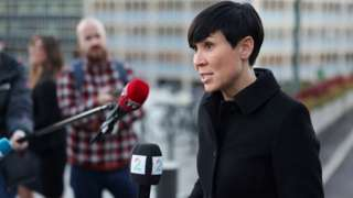 """Norway""""s Foreign Minister Ine Marie Eriksen Soreide talks to the media outside the Ministry of Foreign Affairs due the Norwegian government believing that Russia is behind a cyber attack on the Norwegian Parliament, in Oslo, Norway October 13, 2020."""