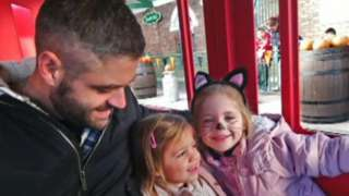 Andy Wilkes with his daughters Penny and Faye