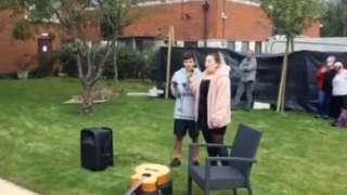 Billy Devine and Ellie Marie Scott singing