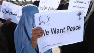 Afghans hold placards as they rally to support the Doha peace talks between Taliban and the Afghan government, in Herat, Afghanistan, 21 September 2020.