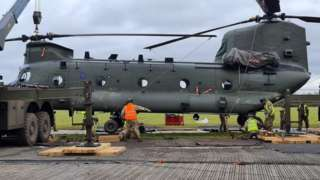 Chinook being lifted from mud