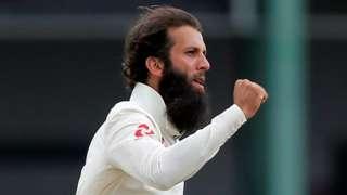 England all-rounder Moeen Ali celebrates taking the wicket of Sri Lanka opener Danushka Gunathilaka late on day three of the third Test in Colombo