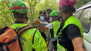 Rescuers hold the child