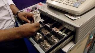 Generic man working on cash register