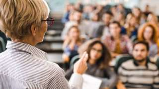 Lecturer in front of a class