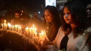 Indian mourners take part in candle light vigil as they pay homage to the killed service members in Siliguri