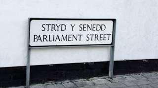 A sign reading Stryd y Senedd... Parliament Street