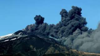Thick black smoke from Mount Etna