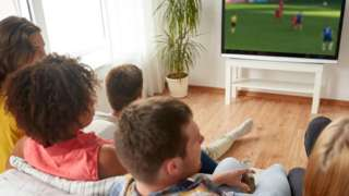 Group watching sport on TV