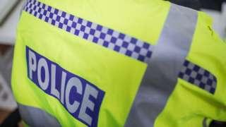 Police officer in high-vis jacket