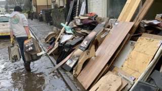 Flooring business with flood damaged goods piled up outside in Nantgarw, Rhondda Cynon Taff