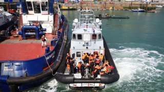 Migrants being brought to Dover on Thursday