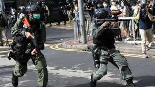 Riot police fire pepper spray in Hong Kong