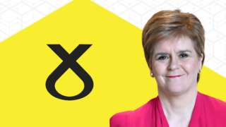 Leader Nicola Sturgeon appears in front of SNP banner