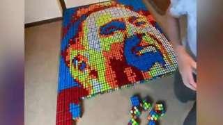 Portrait of Christian Eriksen using Rubik's cubes half complete