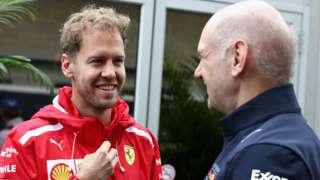 Ferrari's Sebastian Vettel talks with Adrian Newey, the Chief Technical Officer of Red Bull Racing