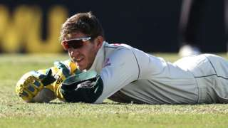 Australia captain Tim Paine lies on the floor after dropping a catch on day five of the third Test against India