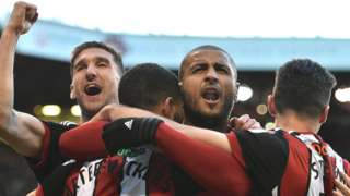 Leon Clarke (second right) celebrates his equaliser for Sheffield United