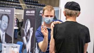 Man given vaccine in Fredrikshavn, Jutland, on 12 April