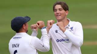 Sussex all-rounder James Coles (right) celebrates taking a wicket