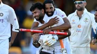 India celebrate beating Australia at the Gabba