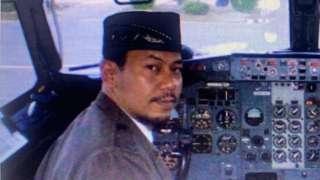 Pilot Captain Afwan in the cockpit of a plane