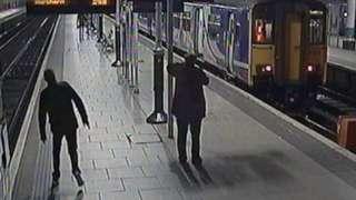Drunk man veering towards rail tracks